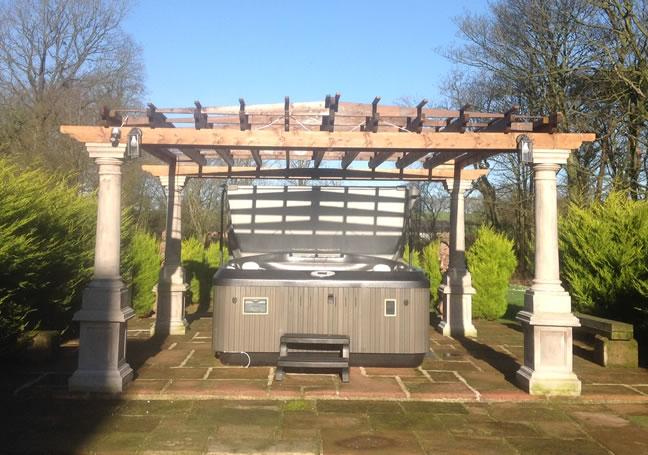 Hot tub in the gardens at Brackenhill self catering cumbria