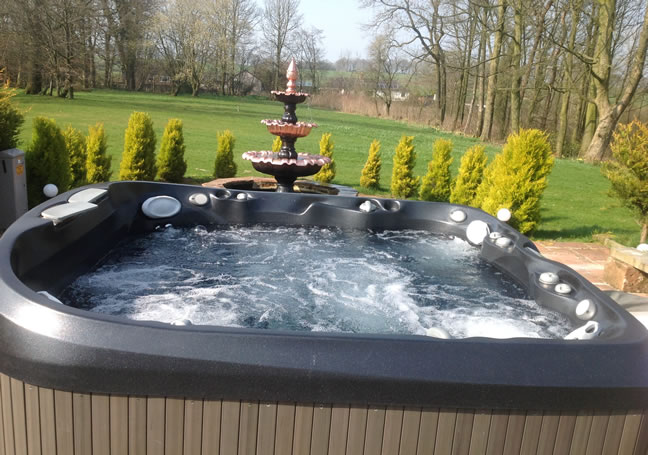 Hot tub in landscaped gardens of Brackenhill Tower